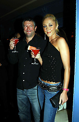 Singer JENNY FROST and her fiance DOM THRUPP at a party to celebrate the launch of Michelle Watches held at the Blue Bar, The Berkeley Hotel, London on 7th October 2004.<br />