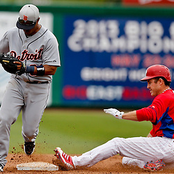 Mar 12, 2013; Clearwater, FL, USA; Detroit Tigers second baseman Ramon Santiago (39) gets a force out on Philadelphia Phillies designated hitter Chase Utley (26) during the XXXX inning of a spring training game at Bright House Field. Mandatory Credit: Derick E. Hingle-USA TODAY Sports