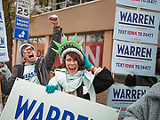 01 NOVEMBER 2019 - DES MOINES, IOWA: Supporters of presidential candidate Elizabeth Warren rally on the streets of Des Moines Friday. Campaign volunteers and surrogates rallied on the streets of Des Moines before the Iowa Democratic Party Liberty and Justice Celebration in the Wells Fargo Arena. About 14,000 people attended the evening event which featured speeches from Democratic candidates for president.           PHOTO BY JACK KURTZ