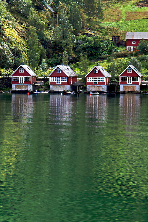 "The village of Flåm gets its name from Old Norse meaning ""little place between steep mountains."" It is located in western Norway along the Aurlandsfjord, a tributary of the Sognefjord, the world's longest and deepest fjord."