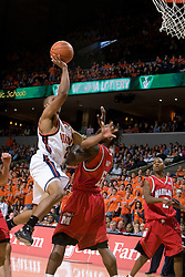 Virginia's J.R. Reynolds (2) heads to the basket over Maryland's James Gist (15).  The Cavaliers defeated the #22 ranked Terrapins 103-91 at the John Paul Jones Arena in Charlottesville, VA on January 16, 2007.