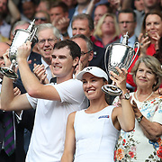 LONDON, ENGLAND - JULY 16:  Jamie Murray of Great Britain and Martina Hingis of Switzerland with the winners trophies after victory over Henri Kontinen of Finland and Heather Watson of Great Britain in the Mixed Doubles Final on Center Court during the Wimbledon Lawn Tennis Championships at the All England Lawn Tennis and Croquet Club at Wimbledon on July 16, 2017 in London, England. (Photo by Tim Clayton/Corbis via Getty Images)