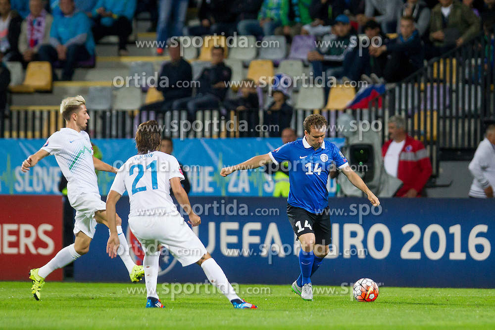 Rene Krhin of Slovenia and Konstantin Vassiljev of Estonia during the EURO 2016 Qualifier Group E match between Slovenia and Estonia at Ljudski vrt on September 8, 2015 in Maribor, Slovenia. Photo by Urban Urbanc / Sportida
