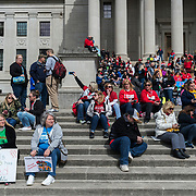 Hundreds of teachers and school personnel sit outside on the steps of the capitol in Charleston, W.V., on Monday, March 05, 2018; the eighth day of statewide school closures.