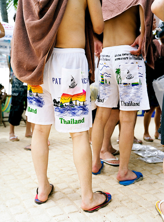 Tourists wearing Thailand branded swimming suits (trunks).