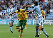 Coventry - Saturday August 9th, 2008: Omar Koroma of Norwich City and Scott Dan of Coventry City in action during the Coca Cola Championship match at The Ricoh Arena, Coventry. (Pic by Michael Sedgwick/Focus Images)