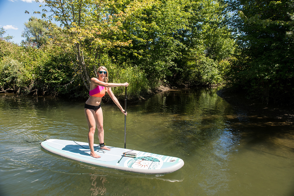 Caitlin Looby paddling at the confluence of the Wenatchee and Columbia Rivers, Washington.