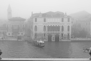 Italy. Venice. Elevated view. Venise San samuelle church and bell tower on the grand canal in the fog - view from Stern hotel - palacio Moro -on Grand Canal  Venice - Italy   / eglise san samuelle et son clocher sur le grand canal dans la brume - vu de l hotel  Stern - palacio Moro - sur le grand canal  Venise - Italie