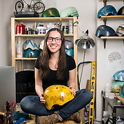 """February 24, 2014 - New York, NY : <br /> Danielle Baskin, founder of Belle Helmets, poses for a portrait in her office/studio space at 115 E. 23rd Street in Manhattan on Monday afternoon, Feb. 24. Danielle hand-paints bicycle helmets, which she sells to clients in New York and across the globe. Her setup includes a 21.5"""" iMac, visible at left.  <br /> CREDIT: Karsten Moran for Macworld Magazin"""