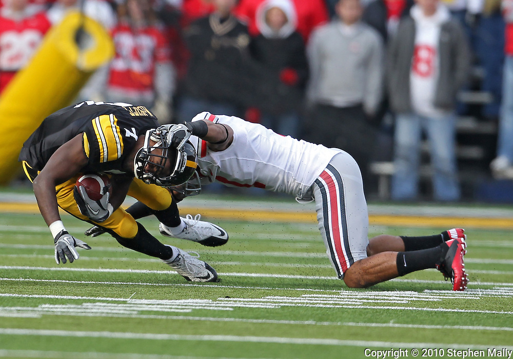 November 20 2010: Iowa Hawkeyes wide receiver Marvin McNutt (7) is pulled down by Ohio State Buckeyes defensive back Devon Torrence (1) during the first quarter of the NCAA football game between the Ohio State Buckeyes and the Iowa Hawkeyes at Kinnick Stadium in Iowa City, Iowa on Saturday November 20, 2010. Ohio State defeated Iowa 20-17.