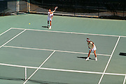 Couple playing tennis