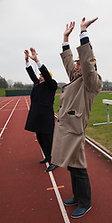 "© Licensed to London News Pictures. 03/03/2012. London, England. L-R: Terry Jones and Michael Palin doing warming up exercises. Terry Jones and Michael Palin of Monty Pythons fame today, Saturday 3 March, staged a public ""Hopathon"" to mark the DVD release of Ripping Yarns The Complete Series, and as an homage to the episode entitled Tomkinsons School Days at the Athletics Track in  Hampstead Heath, London. Photo credit: Bettina Strenske/LNP"