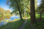 Tranquil morning reflection and riverside path by the Psel River in Sumy, Ukraine