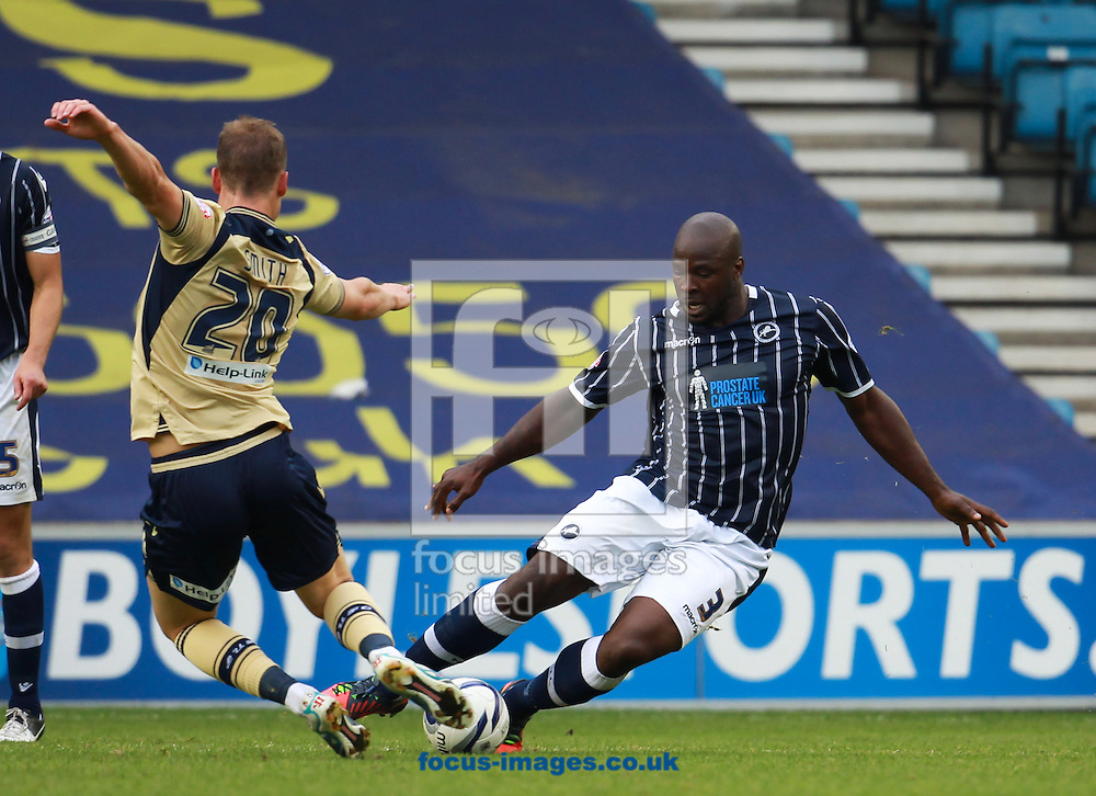 Picture by John Rainford/Focus Images Ltd +44 7506 538356<br /> 28/09/2013<br /> Danny Shittu of Millwall and Matt Smith of Leeds United during the Sky Bet Championship match at The Den, London.