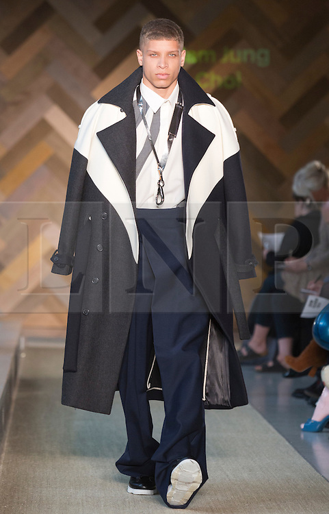 © Licensed to London News Pictures. 29/05/2014. London, England. Collection by Jung Sun Kim. 30 students of the Royal College of Art's prestigious MA Fashion programme presented their final collections in  a runway show at the RCA building in Kensington. Photo credit: Bettina Strenske/LNP