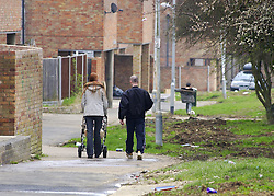 © Licensed to London News Pictures 04/05/2004.A family walk through Craylands estate, an impoverished council estate in Basildon, Essex..Basildon, UK.Photo credit: Anna Branthwaite