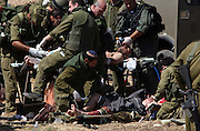 Israeli soldiers who were wounded in south lebanon are treated on the Israel Lebanon border before being evacutated by helicopter to a hospital. At least four Israeli soldiers were wounded in fighting . (Photo by Heidi Levine/Sipa Press).