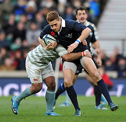 Ed Doe of Oxford University is tackled in possession - Photo mandatory by-line: Patrick Khachfe/JMP - Mobile: 07966 386802 11/12/2014 - SPORT - RUGBY UNION - London - Twickenham Stadium - Oxford University v Cambridge University - The Varsity Match
