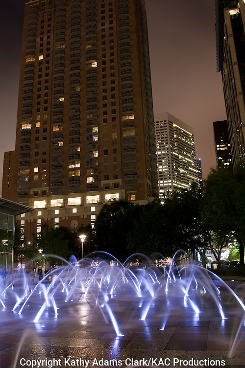 Gateway Fountain, with the skyline of Houston in the background, from Discovery Green Park, in downtown Houston, Texas.