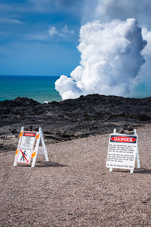 Warning signs at the Kamokuna lava ocean entry, Hawaii Volcanoes National Park, Hawaii USA