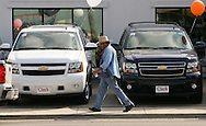 Jay Johnson Castro walks past the Clark Chevrolet dealership in McAllen on his way to Brownsville.