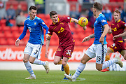 Jake Hastie (#32) of Motherwell FC looks to control the ball as he is shadowed by Scott Tanser (#3) and Jason Kerr (#15) of St Johnstone FC during the Ladbrokes Scottish Premiership match between St Johnstone and Motherwell at McDiarmid Stadium, Perth, Scotland on 11 May 2019.