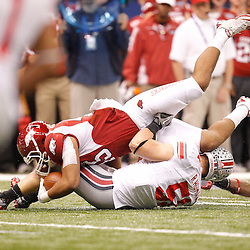 January 4, 2011; New Orleans, LA, USA;  Arkansas Razorbacks tight end D.J. Williams (45) is tackled by Ohio State Buckeyes linebacker Ross Homan (51) during the first quarter of the 2011 Sugar Bowl at the Louisiana Superdome.  Mandatory Credit: Derick E. Hingle