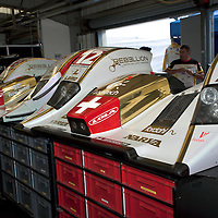 #12 Lola B10/60 (LMP1) nose cones in Rebellion Racing pit garage, Le Mans Series Silverstone 1000KM 2010