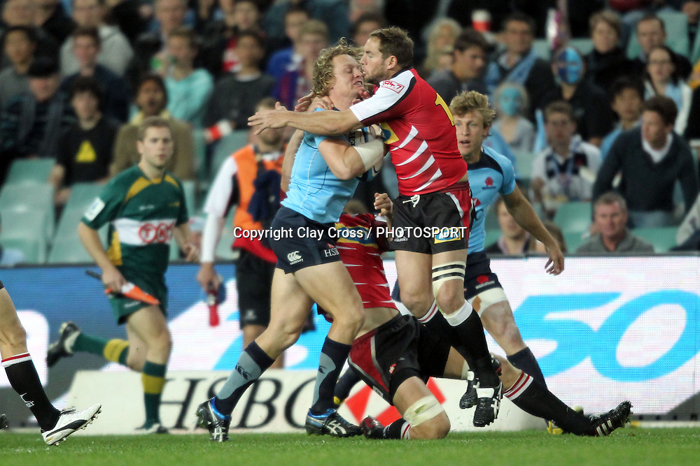 Ryan Cross runs into Butch James. NSW Waratahs v Lions. Investec Super Rugby Round 14 Match, 21 May 2011. Sydney Football Stadium, Australia. Photo: Clay Cross / photosport.co.nz