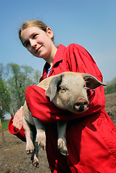 UK ENGLAND WILTSHIRE CHITTERNE 15APR07 - Emma Chianchi (14) holds a British Lop piglet at the Paradise Pig Farm run by Tony York and Carron McCann. Under the 'Pig Perfect' banner the two run a joint farm specialising in rare breeds and offer courses on pig keeping...jre/Photo by Jiri Rezac..© Jiri Rezac 2007..Contact: +44 (0) 7050 110 417.Mobile:  +44 (0) 7801 337 683.Office:  +44 (0) 20 8968 9635..Email:   jiri@jirirezac.com.Web:    www.jirirezac.com..© All images Jiri Rezac 2007 - All rights reserved.