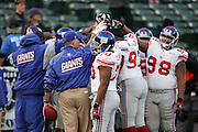 OAKLAND, CA - DECEMBER 31:  The New York Giants in a group huddle before the game against the Oakland Raiders at McAfee Coliseum on December 31, 2005 in Oakland, California. The Giants defeated the Raiders 30-21. ©Paul Anthony Spinelli