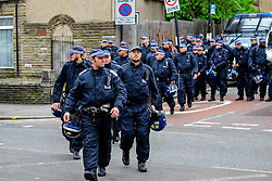 Police arrive in Waltham Forest as anti-fascists gather to protest against a march held by the English Defence League. Walthamstow London May 2015