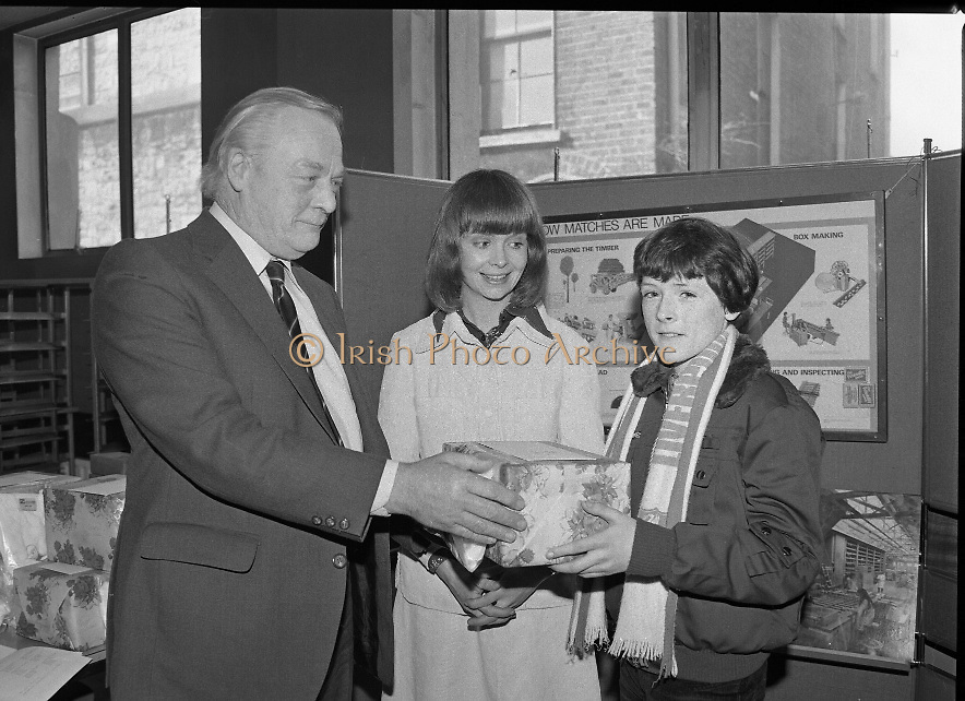 1980-03-07.7th March 1980.07/03/1980.03-07-80..Photographed at Maguire & Paterson, Dublin..Declan Claims his prize:..From Left:..Alan Buttanshaw, Managing Director of Maguire & Paterson..Ruth Buchanan, presenter of RTE's Poparama..Declan Murray (13), Glebe, Donegal Town, winner of 2nd Prize (£25).