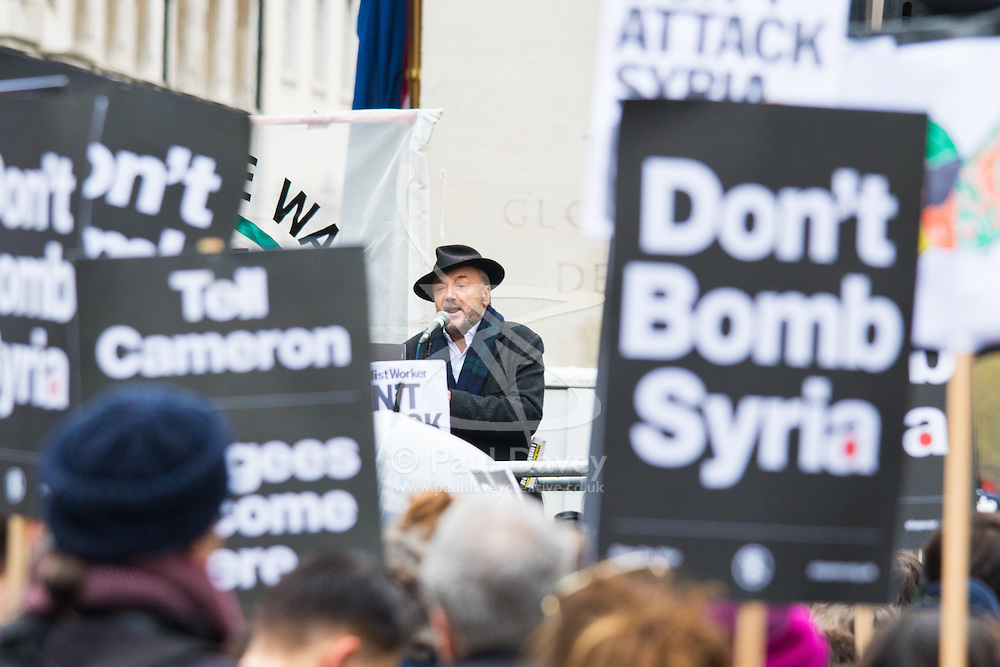London, November 28th 2015. As Prime Minister David Cameron pushes for Parliament to vote to allow aerial strikes against Islamic State targets in Syria, Britain's Stop The War Coalition and thousands of anti-war protesters demonstrate outside Downing Street. PICTURED:  Ousted MP George Galloway addresses the crowd. //// FOR LICENCING CONTACT: paul@pauldaveycreative.co.uk TEL:+44 (0) 7966 016 296 or +44 (0) 20 8969 6875. ©2015 Paul R Davey. All rights reserved.