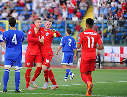 Ross Barkley of England (Everton) celebrates his goal with Wayne Rooney of England (Manchester United)  - Mandatory byline: Joe Meredith/JMP - 07966386802 - 05/09/2015 - FOOTBALL- INTERNATIONAL - San Marino Stadium - Serravalle - San Marino v England - UEFA EURO Qualifers Group Stage