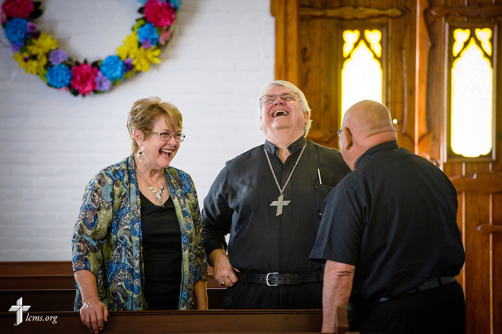 The Rev. Dr. Robert Holaday, pastor of Zion Lutheran Church in Alamo, Texas, and his wife Fern, greet the Rev. Dr. Carlos Hernandez, director of LCMS Church and Community Engagement, before the installation service for the Rev. Dr. Antonio Lopez, new national missionary pastor at El Calvario Lutheran Church on Sunday, July 31, 2016, in Brownsville, Texas. LCMS Communications/Erik M. Lunsford