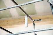 paint roller hanging from a platform