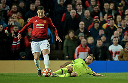 MANCHESTER, ENGLAND - Thursday, April 11, 2019: Barcelona's Ivan Rakitić (L) and Manchester United's Diogo Dalot during the UEFA Champions League Quarter-Final 1st Leg match between Manchester United FC and FC Barcelona at Old Trafford. Barcelona won 1-0. (Pic by David Rawcliffe/Propaganda)