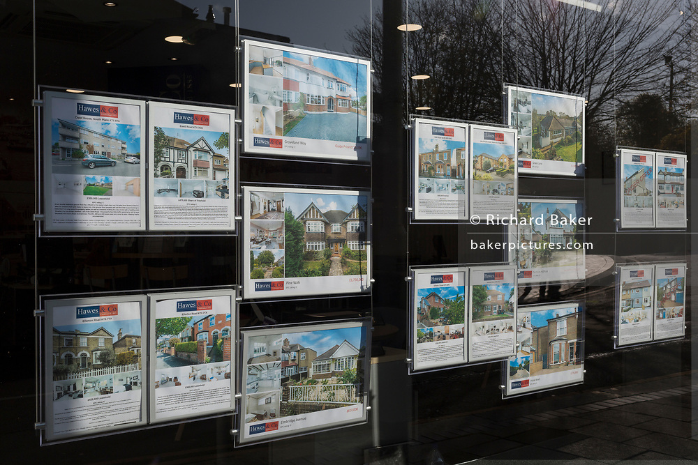 Homes and properties for sale, as seen in the window of south-west London estate agents Hawes & Co, on 7th November 2019, in Surbiton, London, England