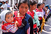 FEB 24, 2001 - SAN CRISTOBAL DE LAS CASAS, CHIAPAS, MEXICO: Mayan Indian women on the Zocalo in San Cristobal de las Casas, Chiapas, Mexico.  © Jack Kurtz   CHILDREN  WOMEN   FAMILY   CROWDS   ECONOMY     POVERTY  TOURISM  UNEMPLOYMENT  INDIGENOUS