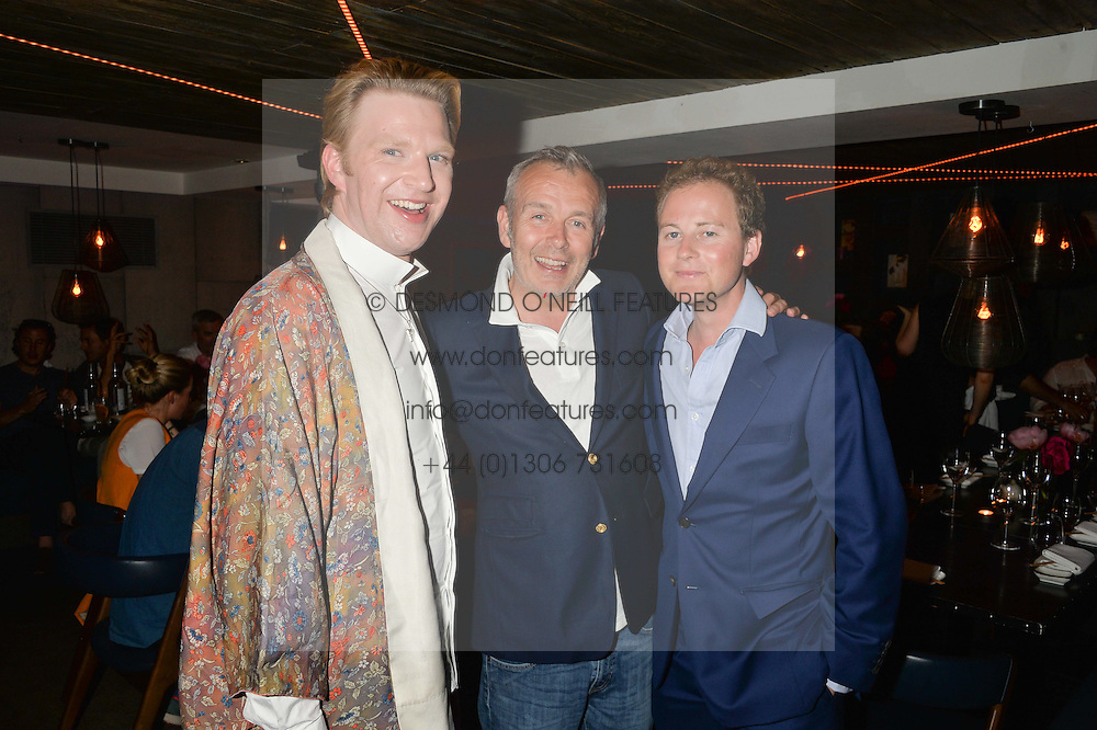 Left to right, HENRY CONWAY, PIERS ADAM and GUY PELLY at the launch of Geisha at Ramusake hosted by Piers Adam and Marc Burton at Ramusake, 92B Old Brompton Road, London on 11th June 2015.