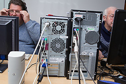 Computer class for people with visual impairments - wiring at back of computers.