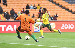 South Africa: Johannesburg: Bafana Bafana player Percy Tau challenges for the ball with Seychelles goalkeeper Romeo Barra during the Africa Cup Of Nations qualifiers at FNB stadium, Gauteng.<br />