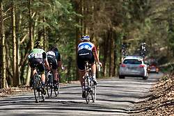 Speeding through the forest - Flèche Wallonne Femmes - a 137km road race from starting and finishing in Huy on April 20, 2016 in Liege, Belgium.