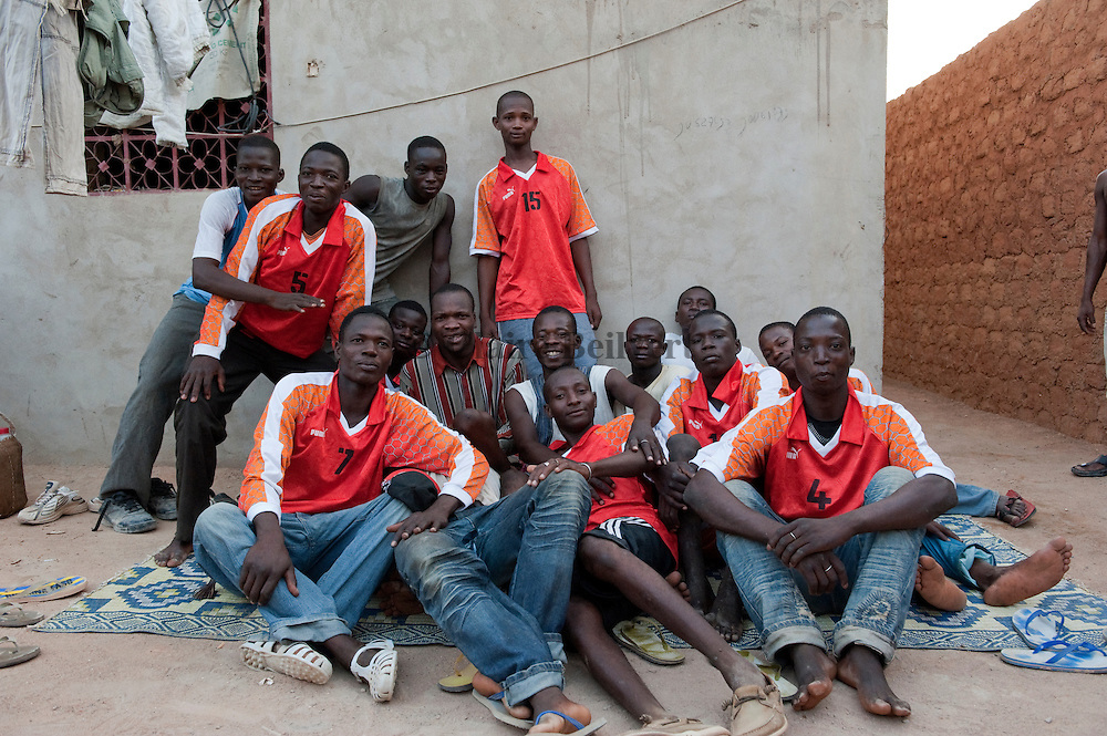 Young migrants from Burkina Faso just after a football match they won