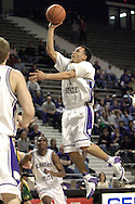 Kansas State guard Schyler Thomas (C) drives the lane to the basket against North Dakota State, during K-State's 82-56 win over North Dakota State at Bramlage Coliseum in Manhattan, Kansas, January 2, 2006.