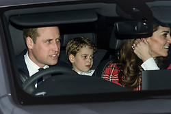 © Licensed to London News Pictures. 18/12/2019. London, UK. PRINCE WILLIAM, DUKE OF CAMBRIDGE, PRINCE GEORGE and CATHERINE DUCHESS OF CAMBRIDGE . Members of the Royal Family seen leaving Buckingham Palace in West London after attending the Queen's annual Christmas lunch. Photo credit: Ben Cawthra/LNP