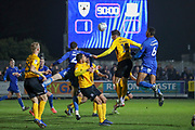 AFC Wimbledon defender Terell Thomas (6) and AFC Wimbledon defender Ryan Delaney (21) battles for possession with Southend United defender Rob Kiernan (15) in the 90th minute during the EFL Sky Bet League 1 match between AFC Wimbledon and Southend United at the Cherry Red Records Stadium, Kingston, England on 1 January 2020.