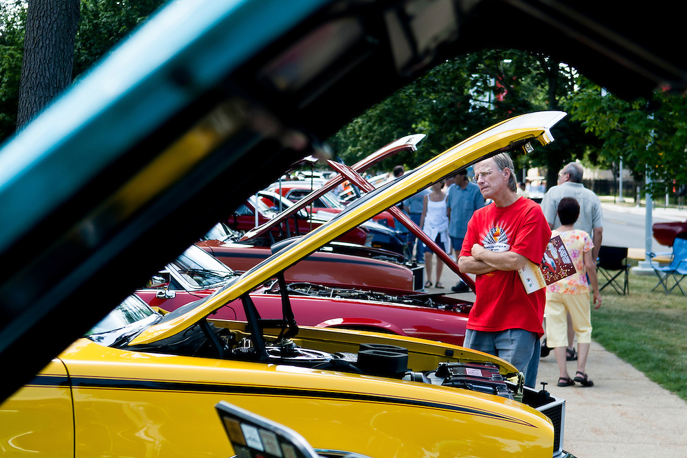 Lathan Goumas | MLive.com..A man looks at cars during the 40th Sloan Museum Auto Fair at the Flint Cultural Center in Flint, Mich. on Saturday, June 23, 2012.