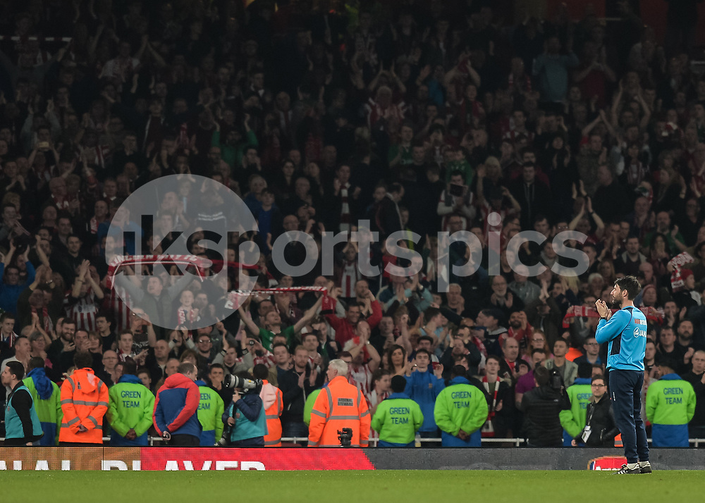 Danny Cowley manager of Lincoln City salutes the Lincoln City fans after the The FA Cup sixth round match between Arsenal and Lincoln City at the Emirates Stadium, London, England on 11 March 2017. Photo by Vince Mignott.